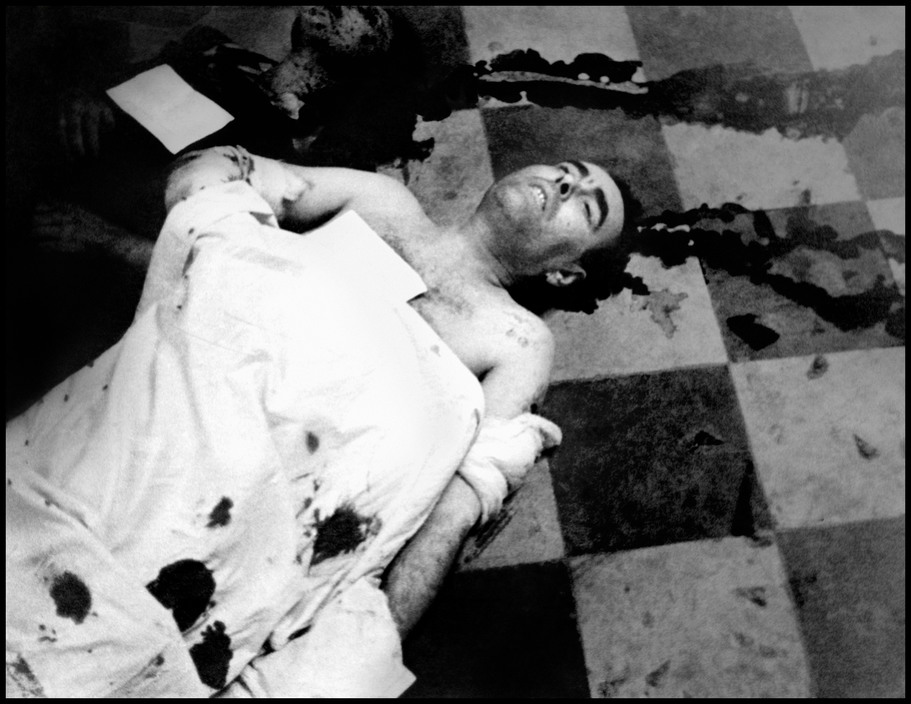 SPAIN. 1936. Spanish Civil War. Air raid victim in the morgue, Valencia, May 1937