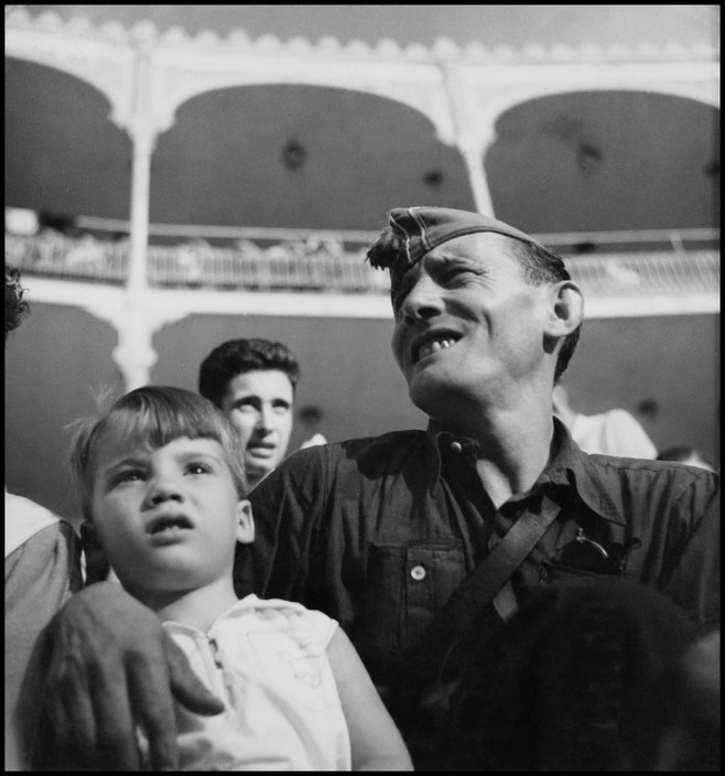 Republican militiaman and child at bullfight and military show, Barcelona, August 1936