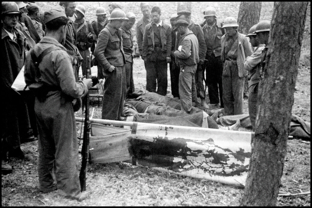 SPAIN. Navacerrada Pass. May-June 1937. Republican soldiers with bloodied stretcher.