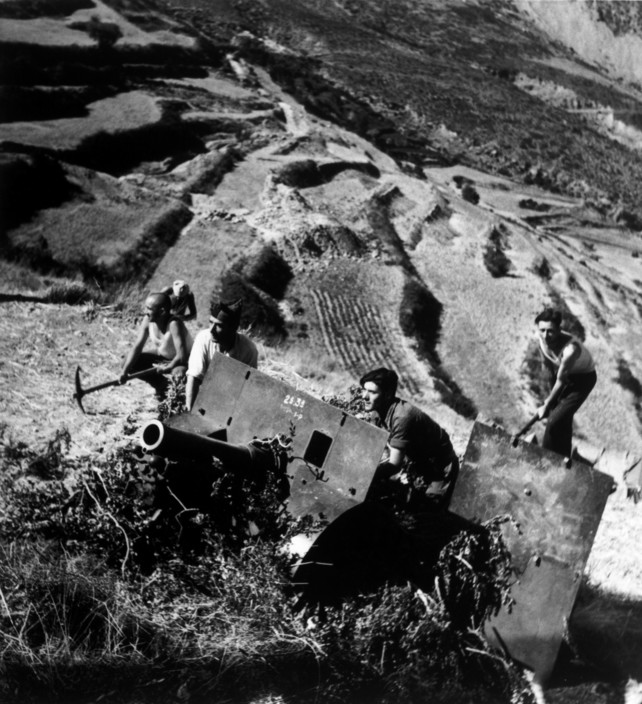 SPAIN. Spanish Civil War (1936-9)  Near Huesca. Aragon front. August/September, 1936. Republican soldiers.   The Spanish Civil War broke out in 1936, when part of the Spanish army rebelled against the Second Republic, a democratic government elected in 1931. It gained international dimensions when Fascist Germany and Italy began supporting the military uprising, led by General Franco, with weapons and soldiers. The USSR helped the Republic, and a significant contingent of volunteers joined the International Brigades and fought for the Republic. The conflict became the symbol of a larger conflict between Fascists and Communists. The war ended in 1939 with Franco's victory over the Republicans.