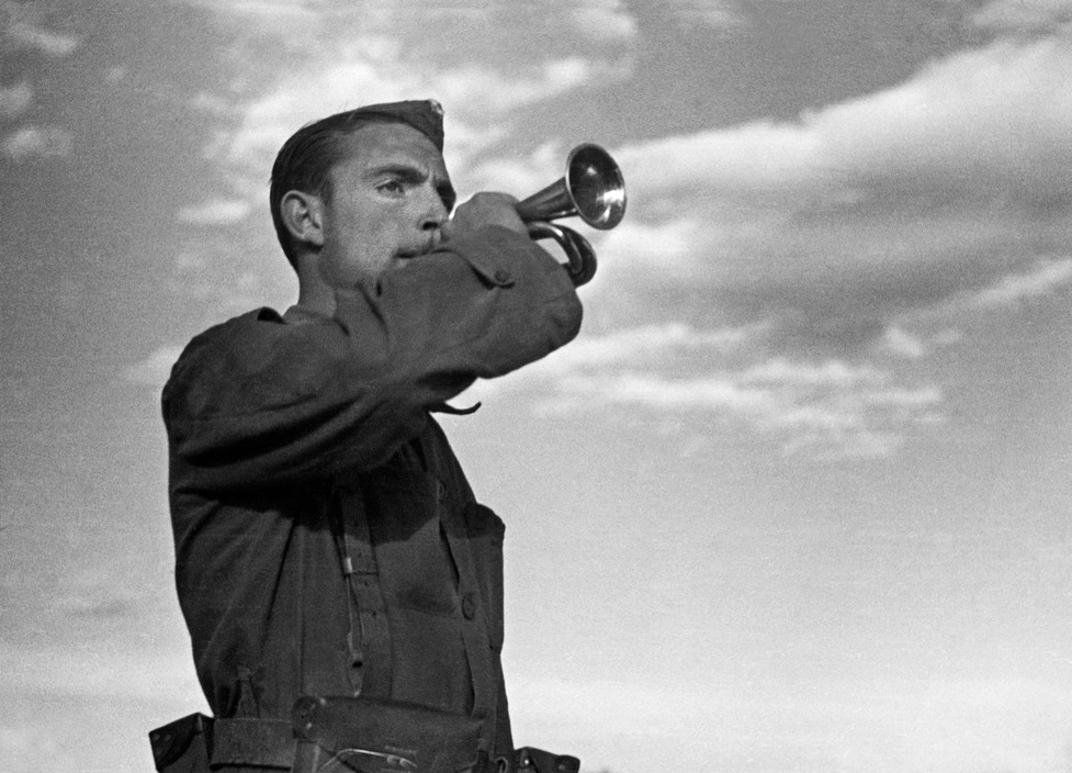 The Spanish Civil War. Republican soldier playing the bugle, Valencia, Spain, March 1937