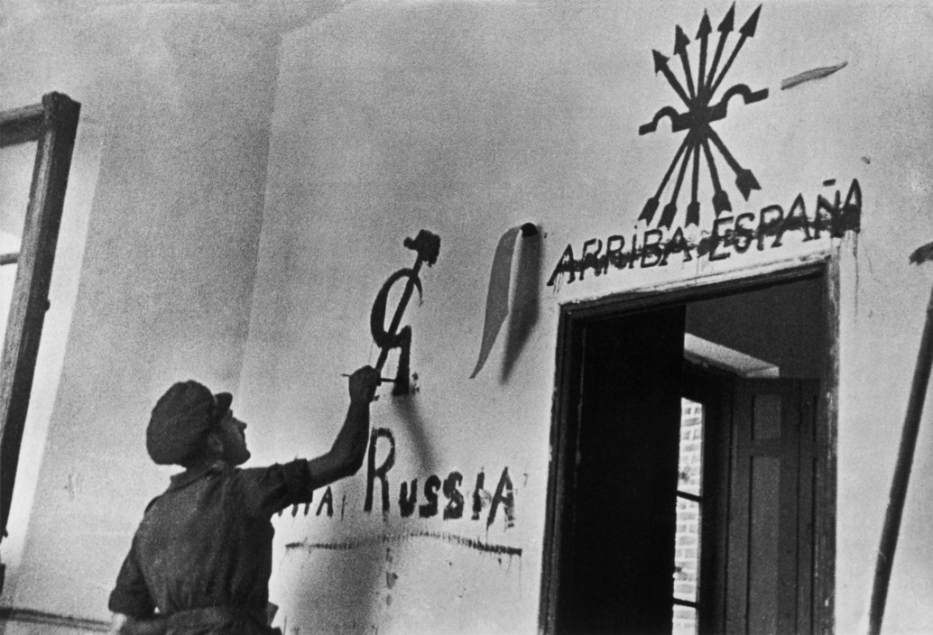 SPANISH. The Spanish Civil War. Aragon. August-September 1936. After having erased the pro-Franco slogan, a republican soldier draws the communist symbol. Août-septembre 1936. Après avoir rayé, sous le faisceau, le slogan franquiste un soldat républicain dessine le symbole communiste.  The Spanish Civil War broke out in 1936, when part of the Spanish army rebelled against the Second Republic, a democratic government elected in 1931. It gained international dimensions when Fascist Germany and Italy began supporting the military uprising, led by General Franco, with weapons and soldiers. The USSR helped the Republic, and a significant contingent of volunteers joined the International Brigades and fought for the Republic. The conflict became the symbol of a larger conflict between Fascists and Communists. The war ended in 1939 with Franco's victory over the Republicans.
