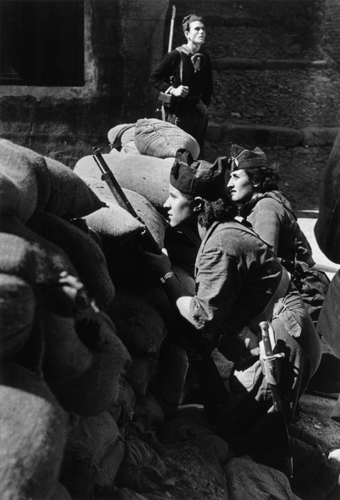 SPAIN. Spanish Civil War (1936-9)Catalonia. Barcelona. August, 1936. Militiawomen defending a street barricade.The Spanish Civil War broke out in 1936, when part of the Spanish army rebelled against the Second Republic, a democratic government elected in 1931. It gained international dimensions when Fascist Germany and Italy began supporting the military uprising, led by General Franco, with weapons and soldiers. The USSR helped the Republic, and a significant contingent of volunteers joined the International Brigades and fought for the Republic. The conflict became the symbol of a larger conflict between Fascists and Communists. The war ended in 1939 with Franco's victory over the Republicans.