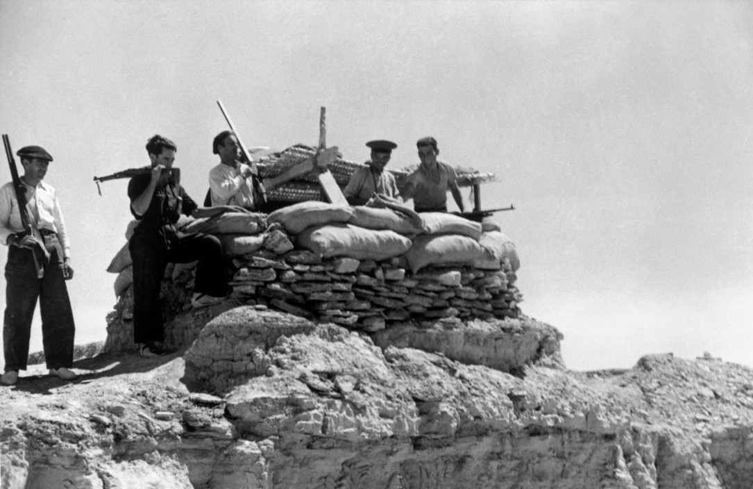 SPAIN. The Spanish Civil War. Near Huesca on the Aragon front. August/September, 1936. Loyalist militiamen. The Spanish Civil War broke out in 1936, when part of the Spanish army rebelled against the Second Republic, a democratic government elected in 1931. It gained international dimensions when Fascist Germany and Italy began supporting the military uprising, led by General Franco, with weapons and soldiers. The USSR helped the Republic, and a significant contingent of volunteers joined the International Brigades and fought for the Republic. The conflict became the symbol of a larger conflict between Fascists and Communists. The war ended in 1939 with Franco's victory over the Republicans.