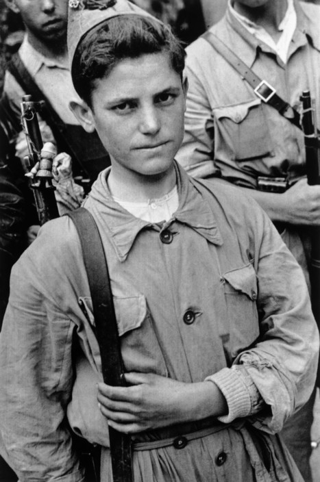 SPAIN. Spanish Civil War (1936-9)  Madrid. August/September, 1936.  A Republican soldier.    The Spanish Civil War broke out in 1936, when part of the Spanish army rebelled against the Second Republic, a democratic government elected in 1931. It gained international dimensions when Fascist Germany and Italy began supporting the military uprising, led by General Franco, with weapons and soldiers. The USSR helped the Republic, and a significant contingent of volunteers joined the International Brigades and fought for the Republic. The conflict became the symbol of a larger conflict between Fascists and Communists. The war ended in 1939 with Franco's victory over the Republicans.