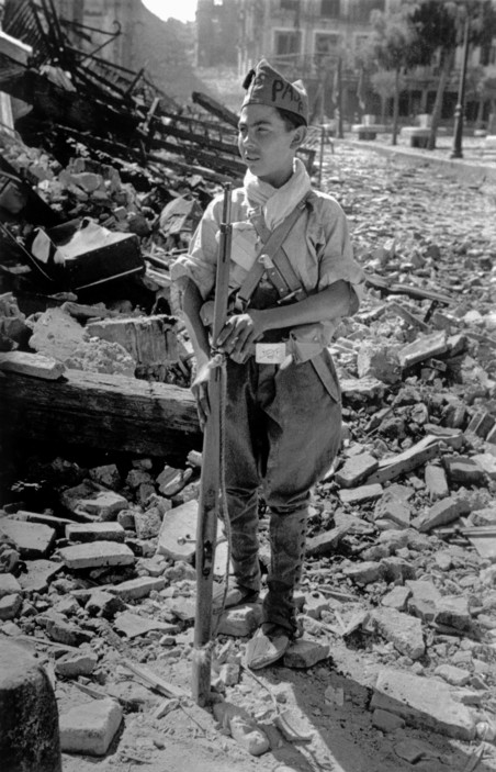 SPAIN. Spanish Civil War (1936-9)  Unknown location. August/September, 1936.  A young Republican soldier.     The Spanish Civil War broke out in 1936, when part of the Spanish army rebelled against the Second Republic, a democratic government elected in 1931. It gained international dimensions when Fascist Germany and Italy began supporting the military uprising, led by General Franco, with weapons and soldiers. The USSR helped the Republic, and a significant contingent of volunteers joined the International Brigades and fought for the Republic. The conflict became the symbol of a larger conflict between Fascists and Communists. The war ended in 1939 with Franco's victory over the Republicans.