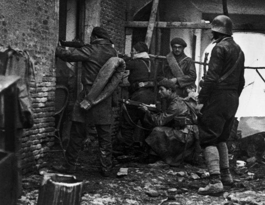 SPAIN. Spanish Civil War (1936-9).  Madrid. November/December, 1936. Members of the International Brigades engaged in a house to house battle around the slaughterhouse, near the university campus, in the western outskirts of the capital. The Fascist rebels were mounting a major offense in order to capture Madrid.   The Spanish Civil War broke out in 1936, when part of the Spanish army rebelled against the Second Republic, a democratic government elected in 1931. It gained international dimensions when Fascist Germany and Italy began supporting the military uprising, led by General Franco, with weapons and soldiers. The USSR helped the Republic, and a significant contingent of volunteers joined the International Brigades and fought for the Republic. The conflict became the symbol of a larger conflict between Fascists and Communists. The war ended in 1939 with Franco's victory over the Republicans.