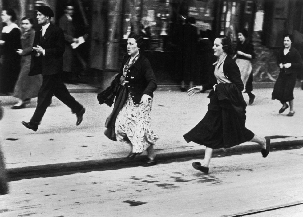 icp 230 Bilbao. Basque region. May, 1937. Running for shelter during an air raid. The Spanish Civil War broke out in 1936, when part of the Spanish army rebelled against the Second Republic, a democratic government elected in 1931. It gained international dimensions when Fascist Germany and Italy began supporting the military uprising, led by General Franco, with weapons and soldiers. The USSR helped the Republic, and a significant contingent of volunteers joined the International Brigades and fought for the Republic. The conflict became the symbol of a larger conflict between Fascists and Communists. The war ended in 1939 with Franco's victory over the Republicans.