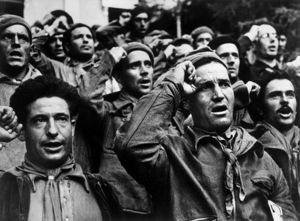 ICP 248 Montblanch. Near Barcelona. October 25th, 1938. Bidding farewell to the International Brigades, which were dismissed by the Republican government, as a consequence of Stalin's friendship with Germany. The Spanish Civil War broke out in 1936, when part of the Spanish army rebelled against the Second Republic, a democratic government elected in 1931. It gained international dimensions when Fascist Germany and Italy began supporting the military uprising, led by General Franco, with weapons and soldiers. The USSR helped the Republic, and a significant contingent of volunteers joined the International Brigades and fought for the Republic. The conflict became the symbol of a larger conflict between Fascists and Communists. The war ended in 1939 with Franco's victory over the Republicans.