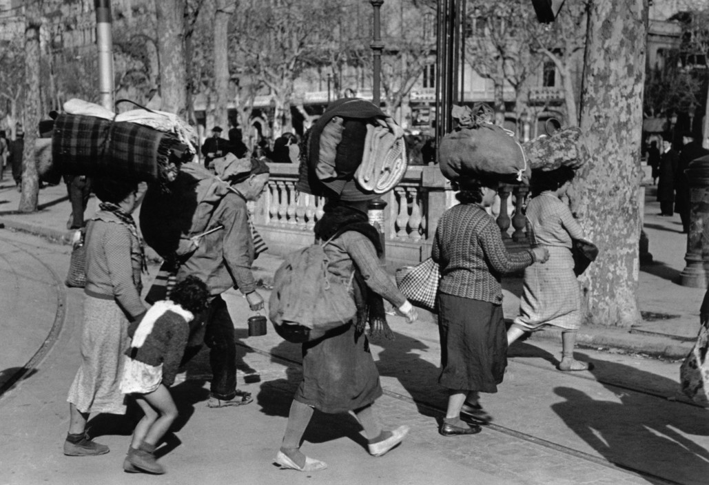 ICP 287 Barcelona. January, 1939. Evacuating the city which was being heavily bombed by fascist planes, as General Franco's fascist troops rapidly approached the city. The Spanish Civil War broke out in 1936, when part of the Spanish army rebelled against the Second Republic, a democratic government elected in 1931. It gained international dimensions when Fascist Germany and Italy began supporting the military uprising, led by General Franco, with weapons and soldiers. The USSR helped the Republic, and a significant contingent of volunteers joined the International Brigades and fought for the Republic. The conflict became the symbol of a larger conflict between Fascists and Communists. The war ended in 1939 with Franco's victory over the Republicans.