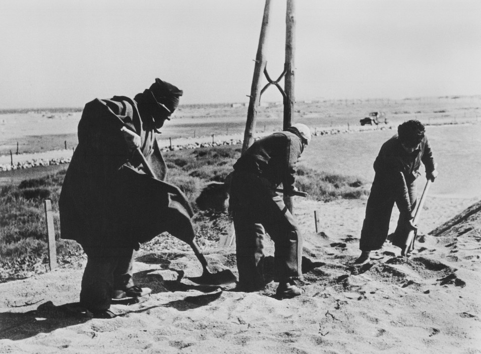 RANCE. Spanish Republicans during Spanish Civil War (1936-39).  icp 310 FRANCE. March, 1939. Argeles-sur-Mer or Le Bercares. Exiled Republican soldiers and civilians, who crossed the border after Franco's victory, being transferred from one refuge camp to another. A French Gendarme heads the column of refugees. France had set up eight camps along the border in the Pyrenees Orientales region.