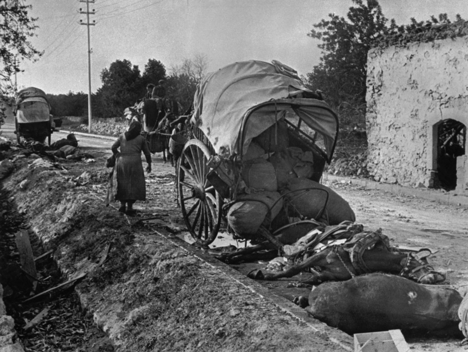 icp 298 On the road from Tarragona to Barcelona. January 15th, 1939. People from Tarragona seeking refuge in Barcelona, before the evacuation of the city. Many of them were killed or lost their belongings during fascist air raids. The Spanish Civil War broke out in 1936, when part of the Spanish army rebelled against the Second Republic, a democratic government elected in 1931. It gained international dimensions when Fascist Germany and Italy began supporting the military uprising, led by General Franco, with weapons and soldiers. The USSR helped the Republic, and a significant contingent of volunteers joined the International Brigades and fought for the Republic. The conflict became the symbol of a larger conflict between Fascists and Communists. The war ended in 1939 with Franco's victory over the Republicans.