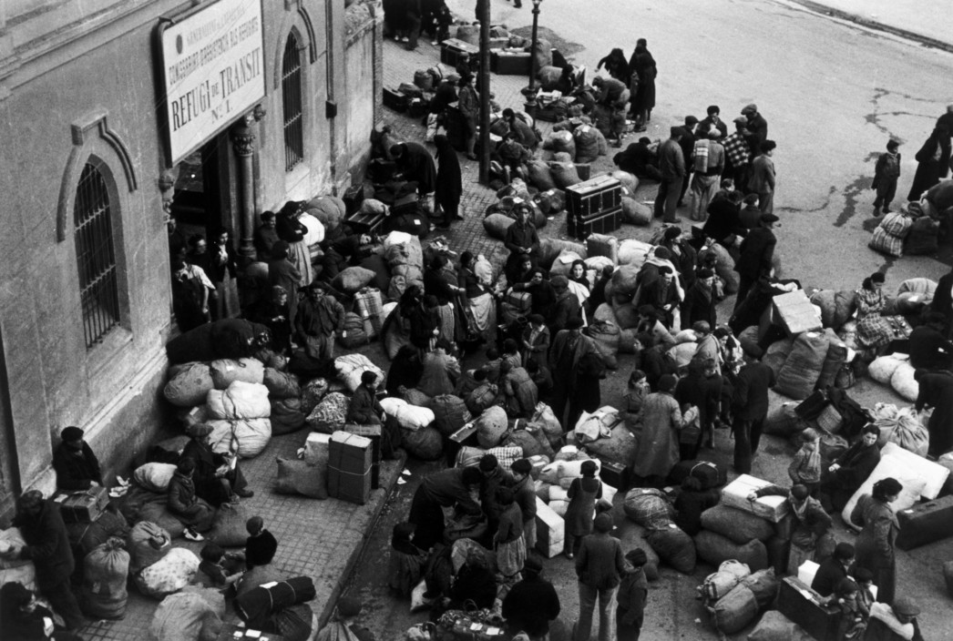 SPAIN. Spanish Civil War (1936-9)  ICP 289. Barcelona. January, 1939. A refugee transit center during the evacuation of the city, which was being heavily bombed by fascist planes, as General Franco's fascist troops rapidly approached. The Spanish Civil War broke out in 1936, when part of the Spanish army rebelled against the Second Republic, a democratic government elected in 1931. It gained international dimensions when Fascist Germany and Italy began supporting the military uprising, led by General Franco, with weapons and soldiers. The USSR helped the Republic, and a significant contingent of volunteers joined the International Brigades and fought for the Republic. The conflict became the symbol of a larger conflict between Fascists and Communists. The war ended in 1939 with Franco's victory over the Republicans.