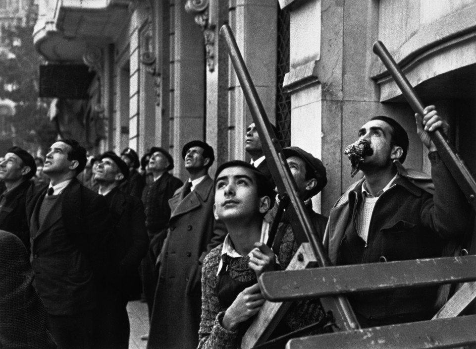 SPAIN. Spanish Civil War (1936-9) ICP 280. Barcelona. January, 1939. Watching an air raid over the city. Barcelona was being heavily bombed by fascist planes, as General Franco's troops rapidly approached. The Spanish Civil War broke out in 1936, when part of the Spanish army rebelled against the Second Republic, a democratic government elected in 1931. It gained international dimensions when Fascist Germany and Italy began supporting the military uprising, led by General Franco, with weapons and soldiers. The USSR helped the Republic, and a significant contingent of volunteers joined the International Brigades and fought for the Republic. The conflict became the symbol of a larger conflict between Fascists and Communists. The war ended in 1939 with Franco's victory over the Republicans.