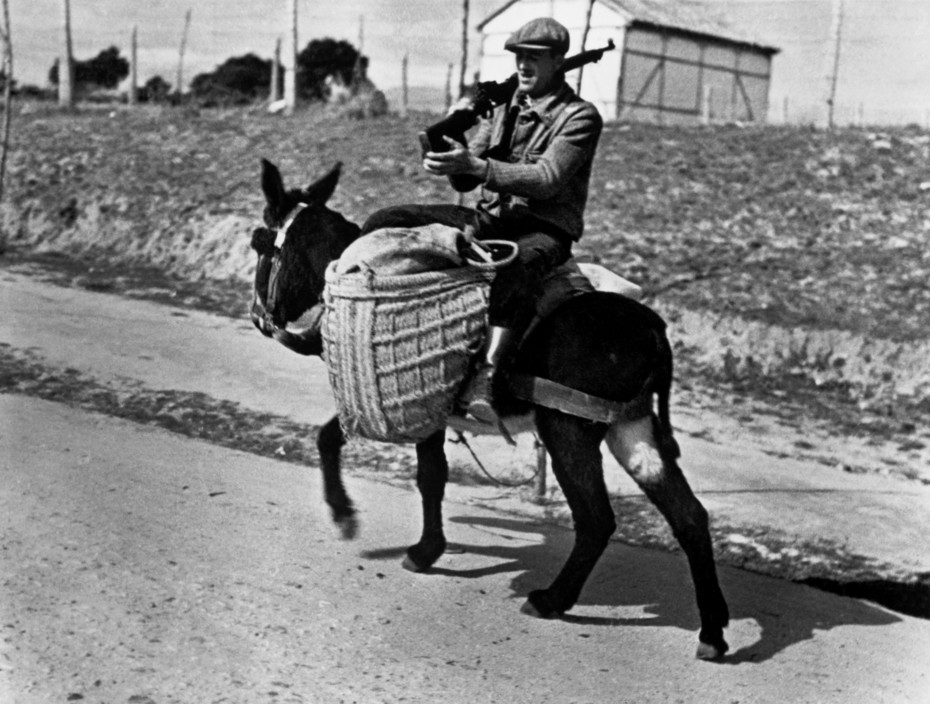 SPAIN. Spanish Civil War (1936-9).  Near Madrid. November, 1936. A Republican soldier.   The Spanish Civil War broke out in 1936, when part of the Spanish army rebelled against the Second Republic, a democratic government elected in 1931. It gained international dimensions when Fascist Germany and Italy began supporting the military uprising, led by General Franco, with weapons and soldiers. The USSR helped the Republic, and a significant contingent of volunteers joined the International Brigades and fought for the Republic. The conflict became the symbol of a larger conflict between Fascists and Communists. The war ended in 1939 with Franco's victory over the Republicans.