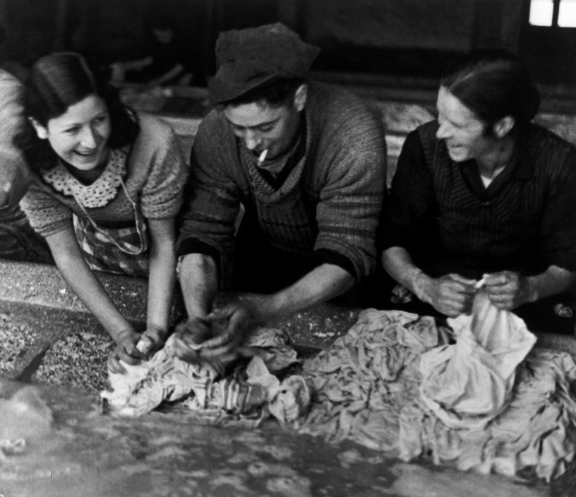 SPAIN. Spanish Civil War (1936-9).  Madrid. November/December, 1936. Republican soldiers helping women do the laundry for the troops.    The Spanish Civil War broke out in 1936, when part of the Spanish army rebelled against the Second Republic, a democratic government elected in 1931. It gained international dimensions when Fascist Germany and Italy began supporting the military uprising, led by General Franco, with weapons and soldiers. The USSR helped the Republic, and a significant contingent of volunteers joined the International Brigades and fought for the Republic. The conflict became the symbol of a larger conflict between Fascists and Communists. The war ended in 1939 with Franco's victory over the Republicans.