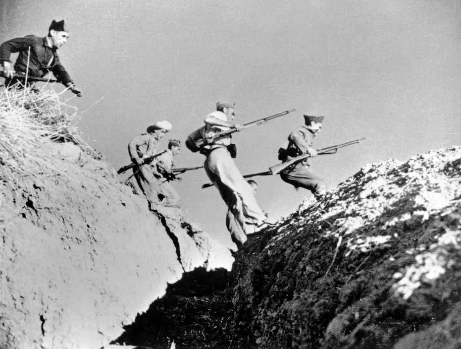 SPAIN. Spanish Civil War (1936-9). The Republican side. Andalusia. Near Cerro Muriano.  Cordoba front. September 5th 1936 (?).The Spanish Civil War broke out in 1936, when part of the Spanish army rebelled against the Second Republic, a democratic government elected in 1931. It gained international dimensions when Fascist Germany and Italy began supporting the military uprising, led by General Franco, with weapons and soldiers. The USSR helped the Republic, and a significant contingent of volunteers joined the International Brigades and fought for the Republic. The conflict became the symbol of a larger conflict between Fascists and Communists. The war ended in 1939 with Franco's victory over the Republicans.Republican soldiers.