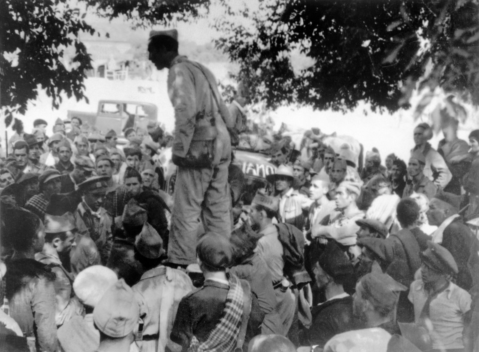SPAIN. Spanish Civil War (1936-9). The Republican side. Andalusia. Cordoba front. September, 1936.The Spanish Civil War broke out in 1936, when part of the Spanish army rebelled against the Second Republic, a democratic government elected in 1931. It gained international dimensions when Fascist Germany and Italy began supporting the military uprising, led by General Franco, with weapons and soldiers. The USSR helped the Republic, and a significant contingent of volunteers joined the International Brigades and fought for the Republic. The conflict became the symbol of a larger conflict between Fascists and Communists. The war ended in 1939 with Franco's victory over the Republicans.An officer addressing the soldiers before an attack.