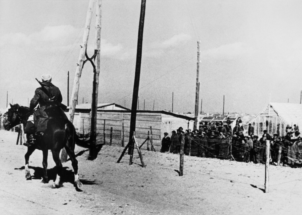 FRANCE. Spanish Republicans during Spanish Civil War (1936-39). ICP 311. FRANCE. March, 1939. Argeles-sur-Mer or Le Bercares. Exiled Republican soldiers and civilians, who crossed the border after Franco's victory, being transferred from one refuge camp to another. A French Gendarme heads the column of refugees. France had set up eight camps along the border in the Pyrénées Orientales region.