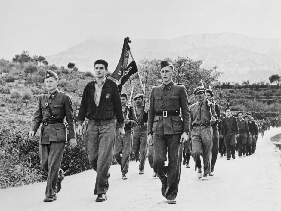 SPAIN. Spanish Civil War (1936-9)  ICP 250. Falset. Near Barcelona. October 16th, 1938. The American Abraham Lincoln Brigade, led by Milt Wolff (front row center), being reviewed. They would soon leave Spain, after having been dismissed by the Republican government, as a consequence of Stalin's friendship with Germany.