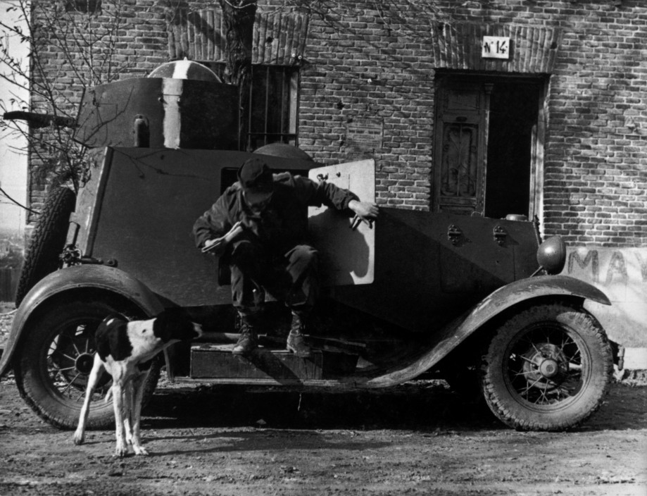 SPAIN. Spanish Civil War (1936-9).  Madrid. November/December, 1936.  An armored car used by officers of the International Brigade.  The Spanish Civil War broke out in 1936, when part of the Spanish army rebelled against the Second Republic, a democratic government elected in 1931. It gained international dimensions when Fascist Germany and Italy began supporting the military uprising, led by General Franco, with weapons and soldiers. The USSR helped the Republic, and a significant contingent of volunteers joined the International Brigades and fought for the Republic. The conflict became the symbol of a larger conflict between Fascists and Communists. The war ended in 1939 with Franco's victory over the Republicans.