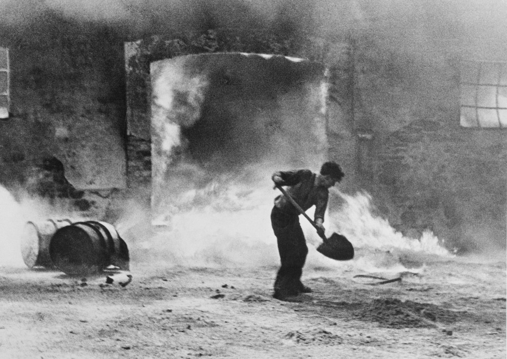 SPAIN. Spanish Civil War (1936/9) ICP 232. Bilbao. Basque region. May, 1937. Extinguishing a fire in a gas deposit hit by an Italo-German air raid. Pays Basque. Bilbao. Mai 1937. Incendie catastrophique d'un dépôt d'essence après les bombardements de l'aviation italo-allemande.  The Spanish Civil War broke out in 1936, when part of the Spanish army rebelled against the Second Republic, a democratic government elected in 1931. It gained international dimensions when Fascist Germany and Italy began supporting the military uprising, led by General Franco, with weapons and soldiers. The USSR helped the Republic, and a significant contingent of volunteers joined the International Brigades and fought for the Republic. The conflict became the symbol of a larger conflict between Fascists and Communists. The war ended in 1939 with Franco's victory over the Republicans.